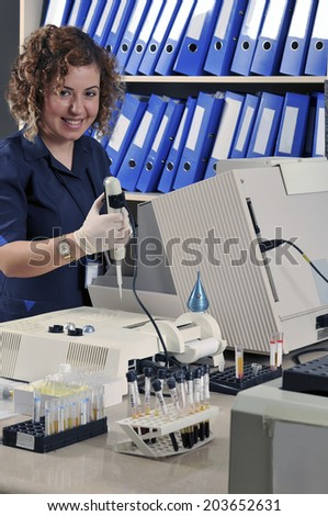 Scientist, pathologist, chemist or other lab worker takes a sample  - stock photo