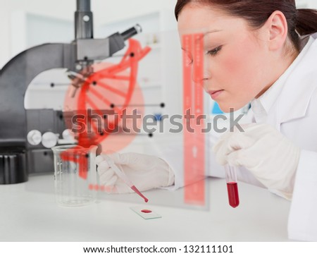 Scientist pouring drop of blood onto glass with futuristic interface in front of her showing DNA - stock photo
