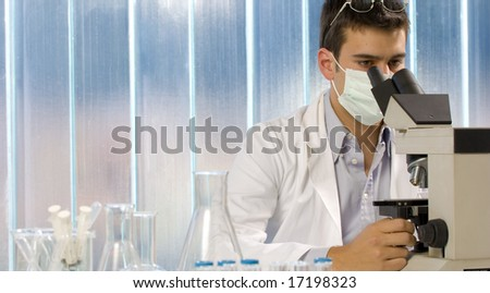 Scientist using a microscope, chemistry related or medical design - stock photo
