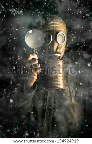 Scientist wearing a gas mask and holding a magnifying glass in a snow storm conducting research into the effects of gases, pollutants and carbon on climate change - stock photo