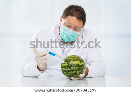 Scientist with chemicals in a lab.  - stock photo