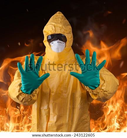 Scientist with protective yellow hazmat suit, ebola concept. - stock photo