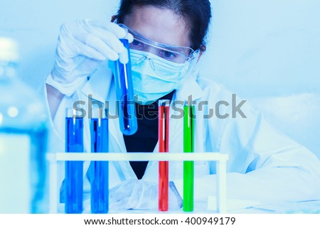 Scientist working,scientists working at the laboratory,scientist leaning against the whiteboard in laboratory,scientist background,female scientist looking microscope in laboratory,scientists studying - stock photo
