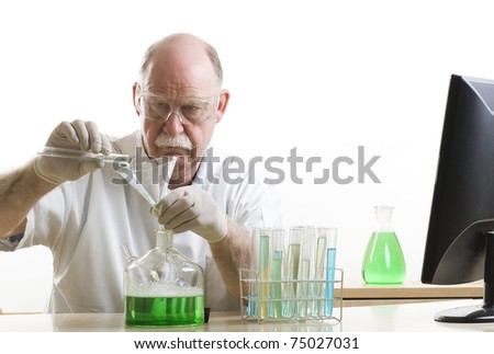 Scientist working with chemicals behind computer