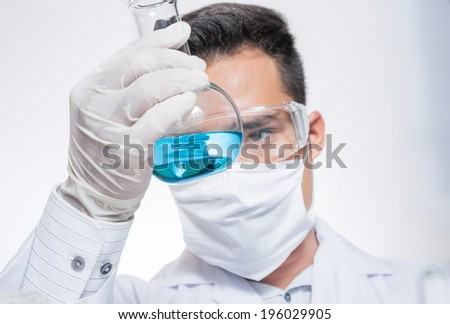 Scientists are experimenting in the lab. - stock photo