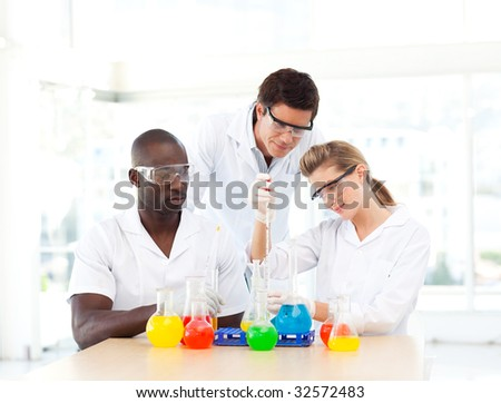 Scientists examining test-tubes in a laboratory - stock photo