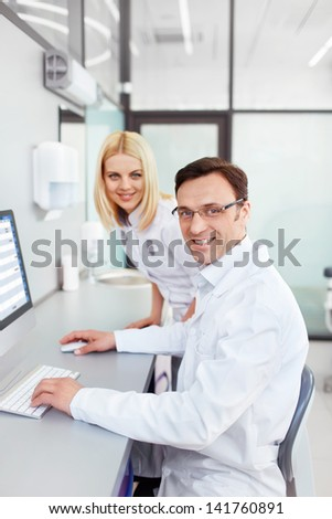 Scientists in a laboratory - stock photo