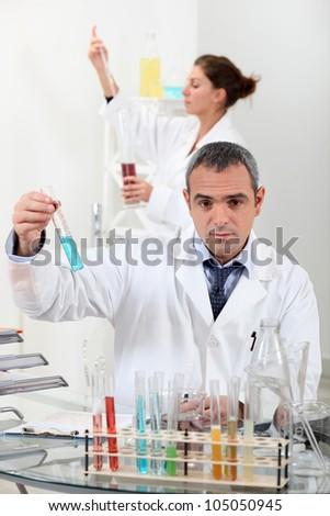 Scientists in laboratory - stock photo