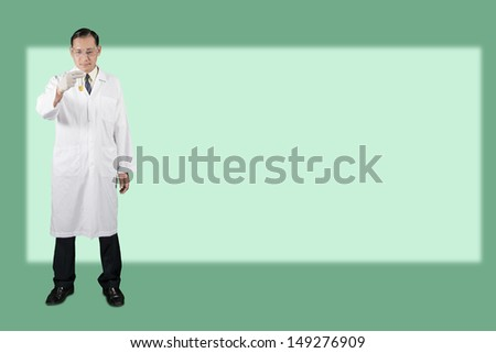 Scientists look the glass tube on green background. - stock photo