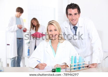 Scientists performing experiments - stock photo