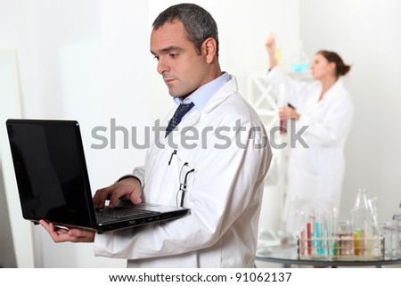 Scientists working in a lab - stock photo