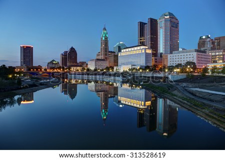 Scioto River and Columbus Ohio skyline at John W. Galbreath Bicentennial Park at dusk - stock photo