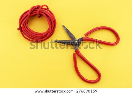 Scissors and cable