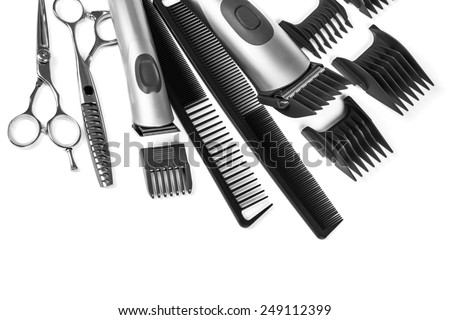 scissors and combs isolated on white background - stock photo