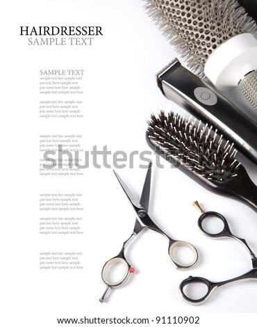 scissors and combs on white - stock photo