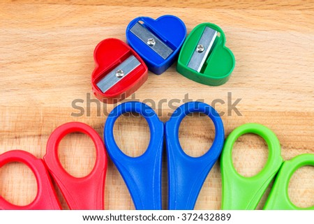 Scissors and Sharpeners on Wooden Table.