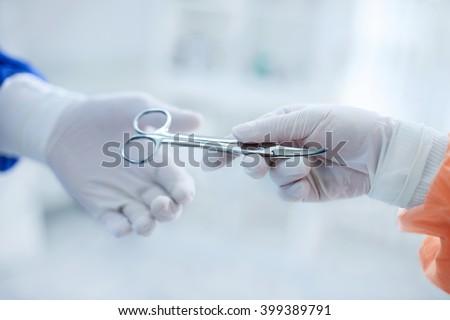 Scissors are ready sterilized for operation - stock photo