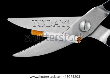 scissors cut a cigarette, isolated on a white background - stock photo