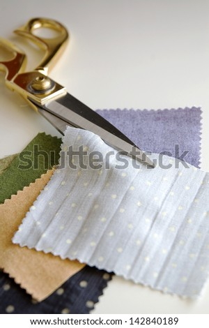 scissors cut on pieces of colorful fabric