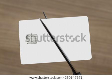 scissors cutting a blank white credit or debit card  - stock photo