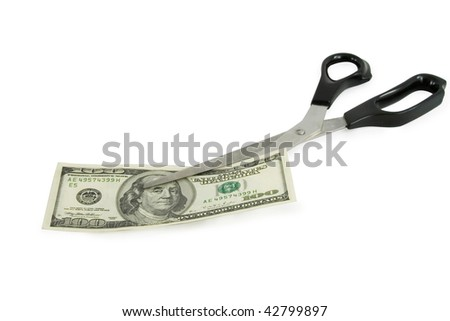 scissors cutting a 100 dollars banknote - stock photo