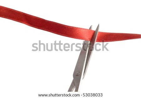 scissors cutting a red ribbon - stock photo