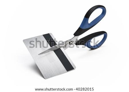 Scissors cutting credit card in halves - stock photo