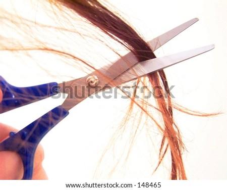 scissors cutting hair - stock photo