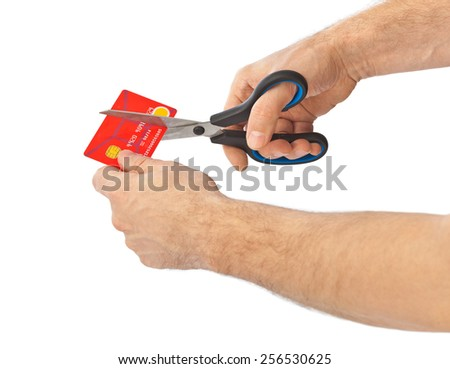 Scissors cutting old credit card isolated on white background - stock photo