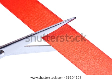 Scissors cutting red ribbon.  Isolated on white background - stock photo