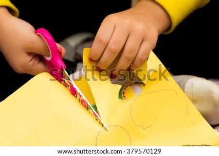 Scissors in child hands - stock photo
