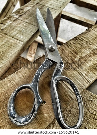 Scissors on the wood background - stock photo