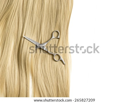 scissors to cut a lock of hair background blond hair - stock photo