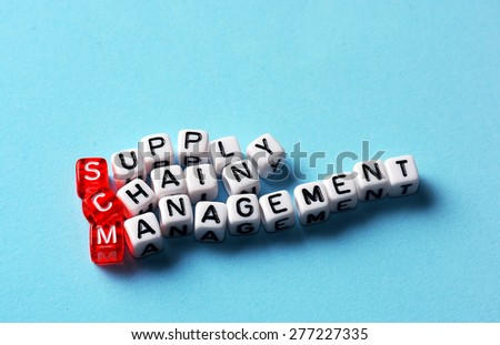 SCM Supply Chain Management written on dices on blue background