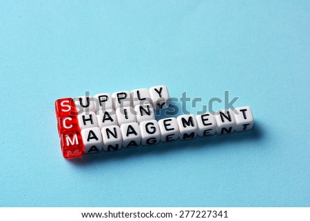 SCM Supply Chain Management written on dices on blue background - stock photo