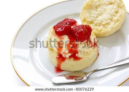 scone with strawberry jam and clotted cream - stock photo