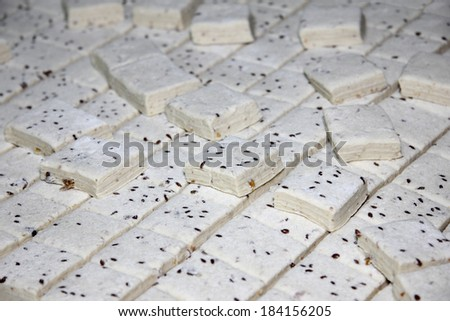 Scones of puff pastry with seeds of flax, ready to bake - stock photo