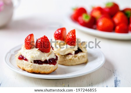 Scones with clotted cream and strawberries - stock photo