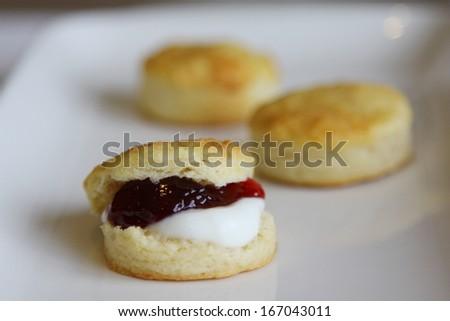 Scones with cream and jam - stock photo