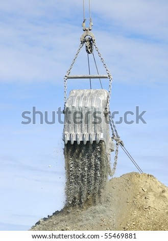 Scoop of dragline in open cast mining quarry - stock photo