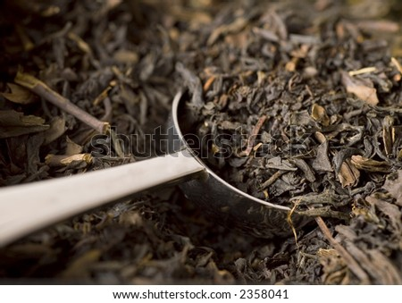 Scoop of Earl Gray black tea. - stock photo