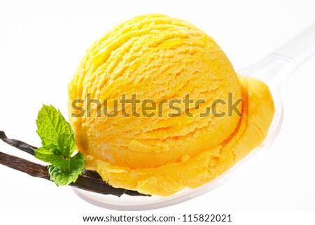 Scoop of vanilla ice cream on a spoon  - stock photo