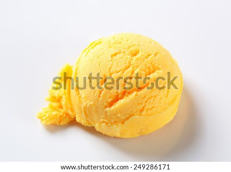 Scoop of yellow ice cream on a plate - stock photo