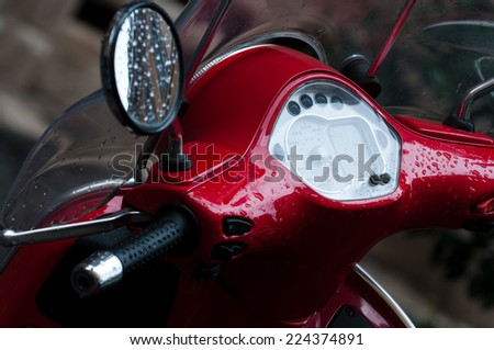 Scooter in rainy day in Italy - stock photo