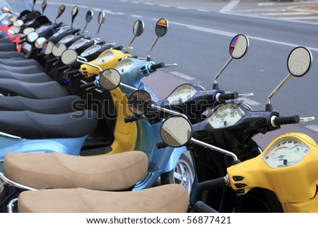 scooter motorbikes row many in rent store - stock photo