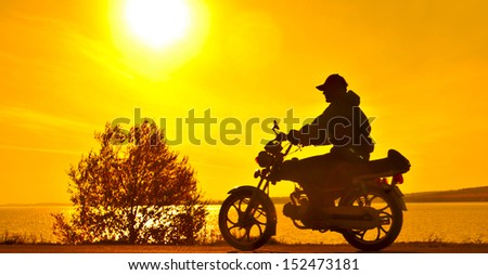 Scooter standing on a hill in the sunset copy Space for inscription