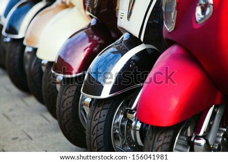 scooter wheels in a row - stock photo