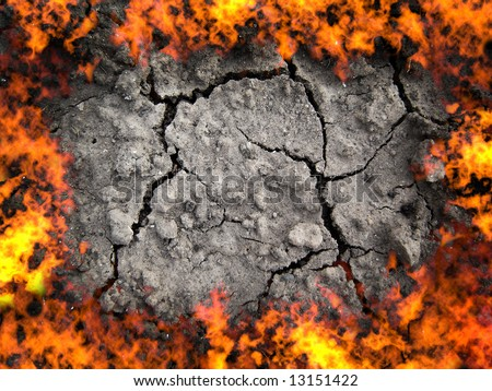 scorched earth, cracky soil and fire flame - stock photo