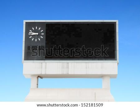 score board at football stadium with bluesky - stock photo