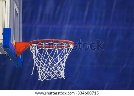 scoring basket in basketball court - stock photo